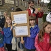 Children hold a banner as the Glasgow 2014 Quee...